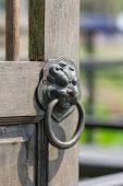 Old Chinese Style Door Handle On Old Wooden Door