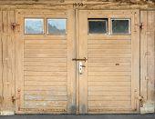 Light brown garage door with windows