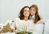 happy mother with daughter at home, real family