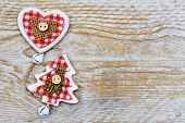 Christmas Tree And Heart Decoration On Wooden Background