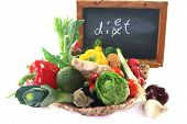 stock photo of dyslexia  - Colorful mix of many different fresh vegetables in a basket with a board - JPG