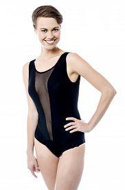 image of monokini  - Smiling sensual woman posing in swimsuit over white - JPG