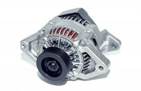picture of dynamo  - New car alternator on a white background