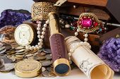 foto of treasure  - Pirate treasure chest with pearls jewels coins and glass - JPG