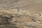 picture of windy  - view from above of a windy road thru the desert in southern California - JPG