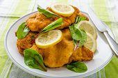 stock photo of veal  - Fried veal fillet with arugula lemon and spinach - JPG