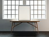 pic of canvas  - Bright loft interior with blank canvas on wood table - JPG
