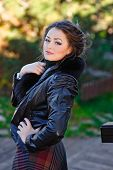portrait of Young woman in black furry hood poster