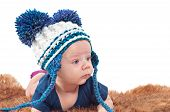 picture of pom-pom  - Closeup portrait of adorable baby in hat with pom - JPG