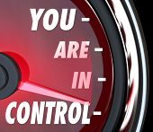 foto of strength  - You Are in Control words on a speedometer to show your power - JPG