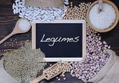image of legume  - Legumes on wooden table in the kitchen - JPG