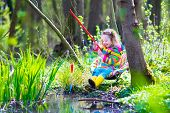 stock photo of wild adventure  - Child playing outdoors - JPG