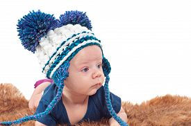 picture of pom poms  - Closeup portrait of adorable baby in hat with pom - JPG