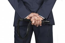 pic of dominate  - Leather whip held by dominant master in a suit - JPG