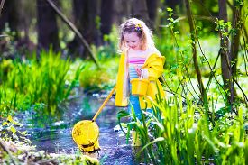 stock photo of baby frog  - Child playing outdoors - JPG