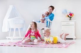 pic of twin baby  - Mother and children play indoors - JPG