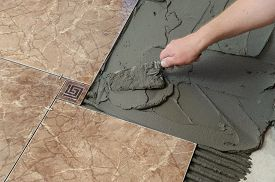 stock photo of ceramic tile  - Laying Ceramic Tiles - JPG