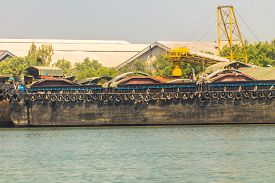 stock photo of barge  - Empty cassava barges floating in river  - JPG
