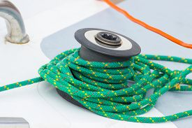 pic of coil  - Yachting coiled green rope and bollard on sailboat details and part of yacht - JPG