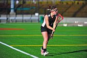 Lacrosse girl with the ball