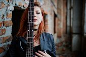 Red Haired Punk Girl Wear On Black With Bass Guitar At Abadoned Place. Portrait Of Gothic Woman Musi poster