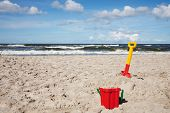 Children's beach toys - buckets, spade and shovel on sand