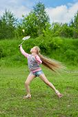 Little girl playing badminton