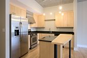 Condo Apartment Contemporary Kitchen. Granite counters, stainless steel appliances