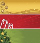 Christmas banner set of yellow gold ornaments, red and silver gifts, and green and sparkle evergreen branches