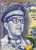 NEPAL - CIRCA 1974: Birendra Bir Bikram (1945 -2001) on 1 Rupee 1974 Banknote from Nepal. King of Ne