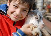 Teenage Boy With Goatling