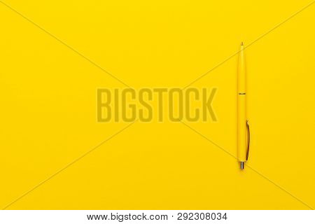 poster of Ballpoint Pen On The Yellow Background. Photo Of Yellow Ballpoint Pen With Copy Space. Minimalist Sh