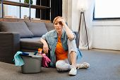 Tired Distressed Woman Feeling Sick After Intense Cleaning poster