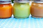 Three Glass Jars Close Up With Baby Puree For The First Feeding Up poster