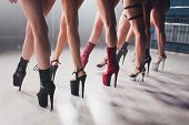 Young Striptease Dancer Moving In High Heels Shoes On Stage In Strip Night Club, Pole Dancing. poster