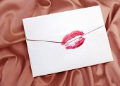 white envelope with lipstick kiss on  gentle silk