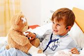 sick child teddy examined