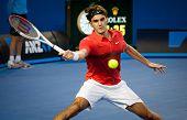 MELBOURNE - JANUARY 22: Roger Federer of Switzerland in his fourth round win over Bernard Tomic of Australia at the 2012 Australian Open on January 22, 2012 in Melbourne, Australia.