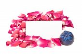 foto of rosepetals  - isolated rosepetals and chocolates with a blank tet card in the middle - JPG