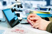foto of dna fingerprinting  - Workplace in the laboratory of genetic research - JPG