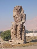 The Colossus of Memnon guards t he entrance to the Valley of the Kings in Egypt
