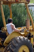 Man In Tractor poster