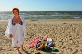 Adult Woman Wrapped Up On Beach