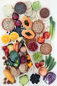 High fibre health food with fresh fruit & vegetables, grains, legumes, seeds, nuts and whole grain c poster