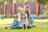 Playful Family Outdoors. Mom With Children In The Summer. Mother And Kids poster