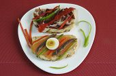 Canapes With Smoked Salmon, Peppers, Egg And Ham