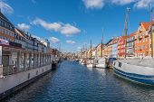 Nyhavn Canal Under A Blue Sky With Some Clouds, Ancient Port In The Center Of The City Of Copenhagen poster
