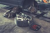 Car Brake Repairing In Garage, Brakes On A Car With Removed Wheel, Car Brake Part At Garage, Car Bra poster