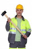 Builder holding sledge-hammer