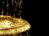 foto of gold glitter  - Abstract fountain flowing with luminous liquid gold - JPG